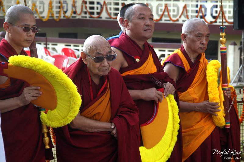 Elderly monks awaiting arrival of His Holiness